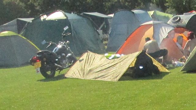 a simply nylon sheet with 2 poles, camping provisions for one rider