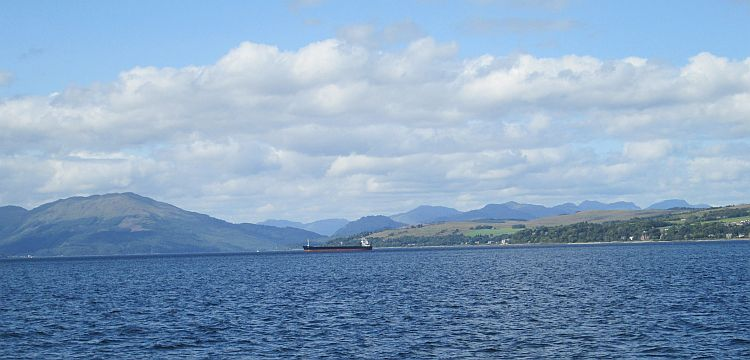 a vast open water surrounded by hills and mountains on the firth of clyde
