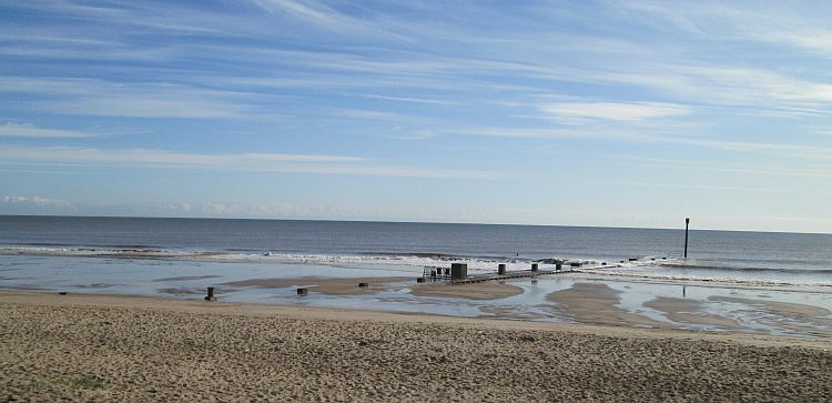 the long broad sandy beach at trusthorpe. Blue skies and completely empty
