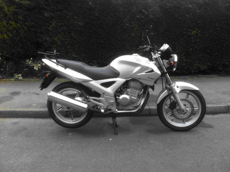 Honda CBF 250 in silver. All standard and very smart