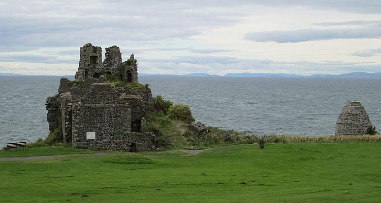 Dunure Castle, just a small tower and doorways in ruin by she ayrshire coastline