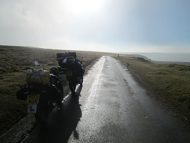 Two 125cc motorcycles on a narrow lane high up in the Dales National Park