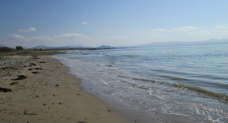 a long beach stretches off to the Welsh mountains in the far distance