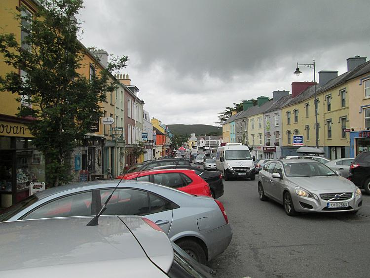 A car filled and busy main street through Kenmare
