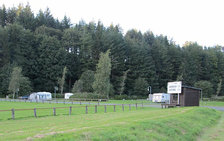 A local rugby club with some caravans on a patch of grass nearby. Ewes Water