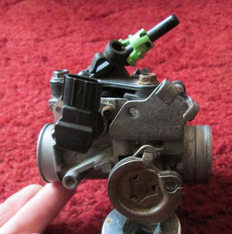 A fuel injection throttle body from a CBF 125