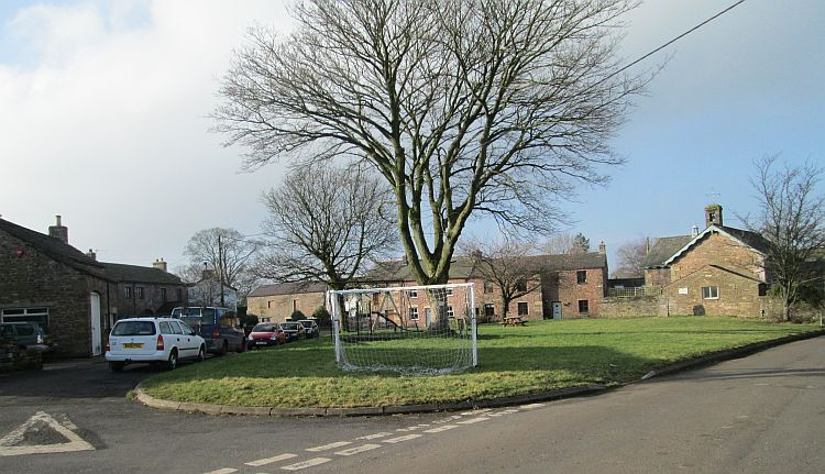 The village of Winton. Village green, stone built cottages and a large tree