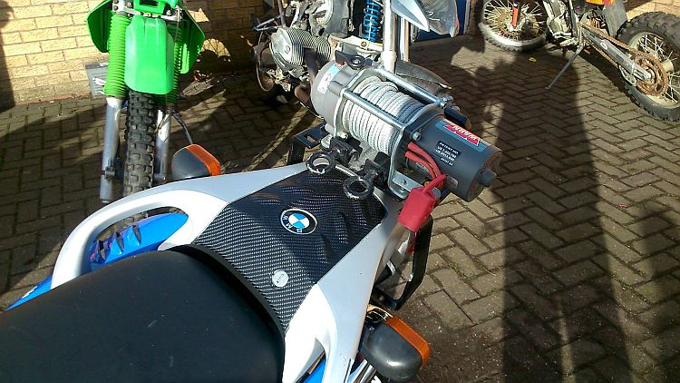 a small but powerful winch fitted to the rear rack of a BMW motorcycle