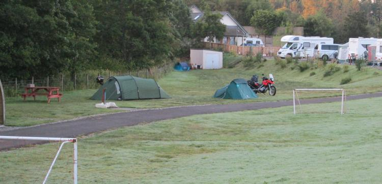 Ren and Mark's motorcycles and tents on a dew heavy morning at Keltie Bridge campsite