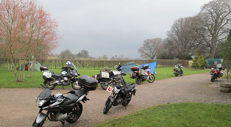 several motorcycles including the 125s at the campsite near kirkby stephen
