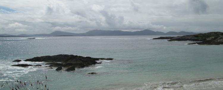 A beach and views across to mountains in the ring of kerry