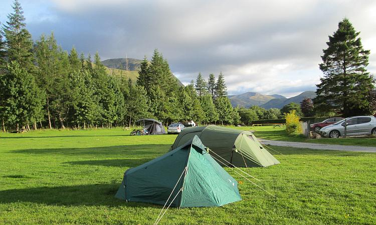 Mark and Ren's tents at lochy holiday park. Trees and Ben Nevis in the background