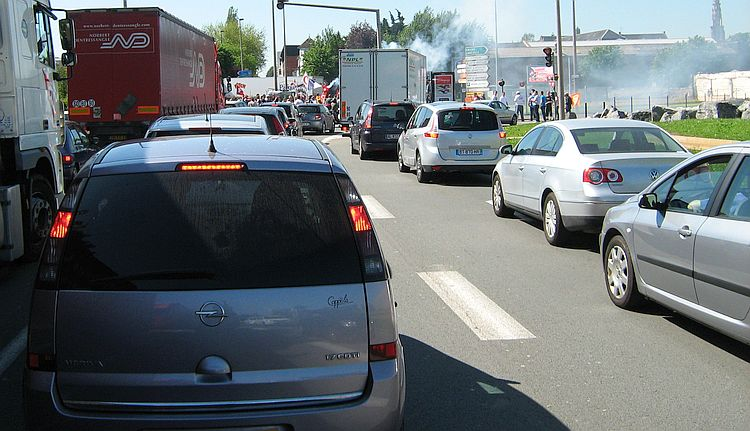 A line of cars and lorries in a traffic jam on a warm summer's day