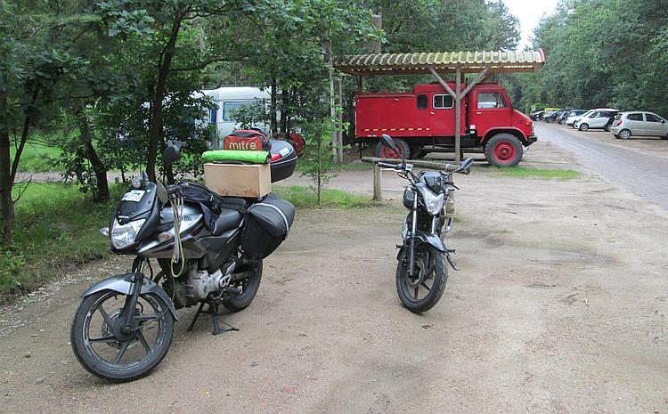 The two 125cc motorcycles being loaded with the camping gear at Distelloo