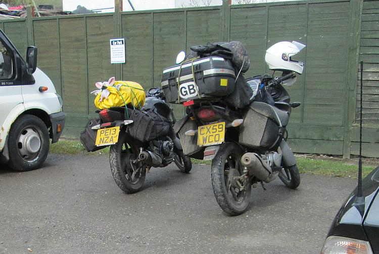 2 very loaded up 125cc motorcycles ready for a camping trip