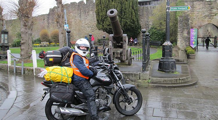 The 2 125 bikes outside Ludlow castle next to an old cannon