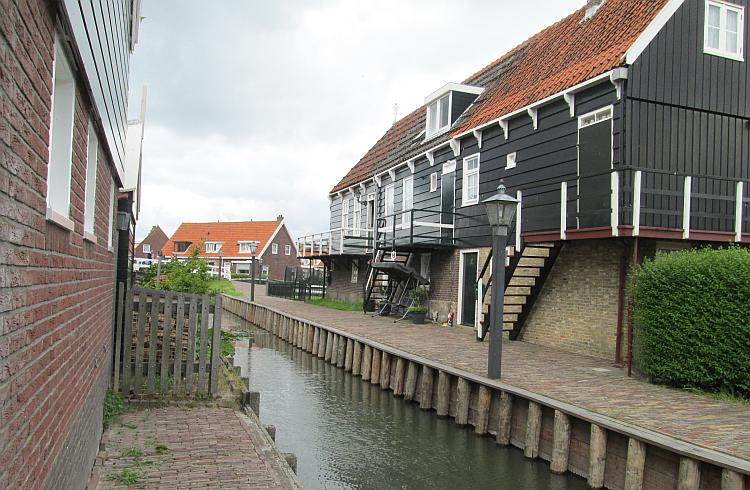 A house , bricks on the bottom half, wood on top, quite old, in Marken