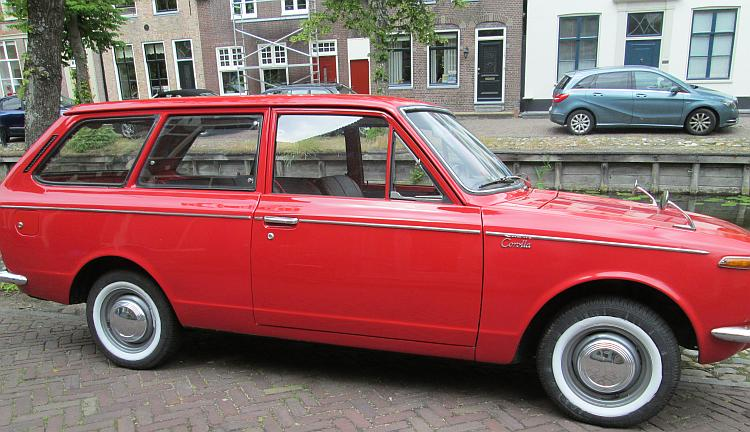 A mint condition classic toyota corolla by a canal in Edam