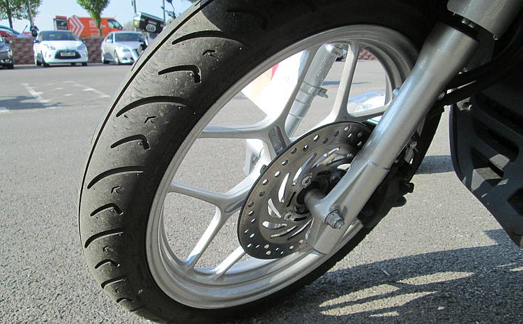The front brake and front wheel of Honda's scooter