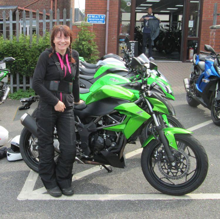 Sharon with a nervous smile when she collected the new bike