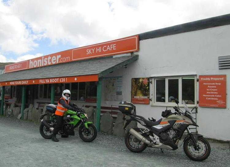 Sharon on her Kawasaki outside the Sky High Cafe on Honister pass