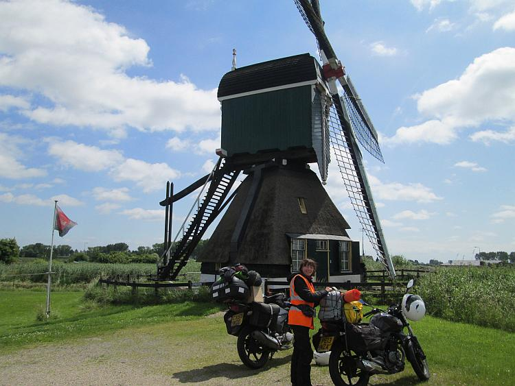 A large old style windmill with the 2 125cc bikes in front of it