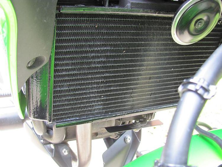 The radiator up close and you can see a piece of metal below it to deflect stones from the front wheel