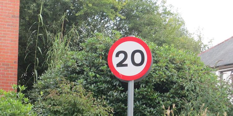 A sign showing a speed limit of 20 miles per hour
