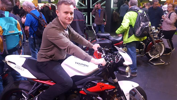 Aaron sits upon the Triumph Street Triple R 675