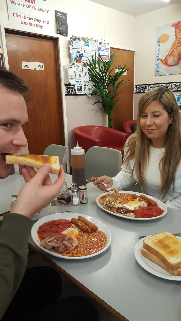 Pete's daughter and her partner Aaron tuck into a hearty breakfast at truckers rest