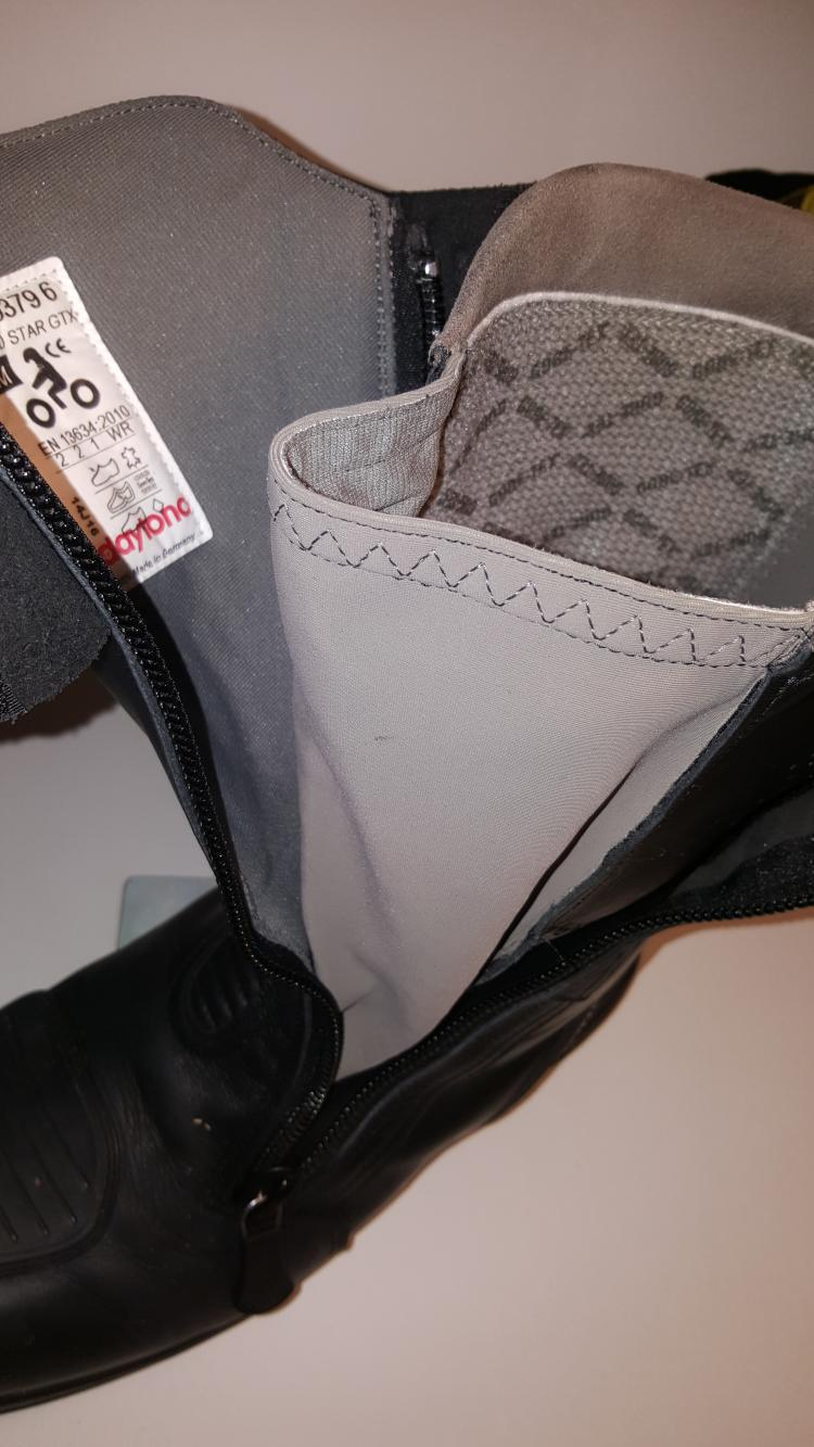 The daytona boot opened up showing the lining and adjustment