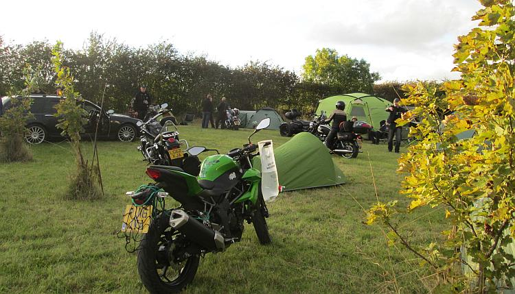 Sharon's 250 in a field surrounded by tents and bikers