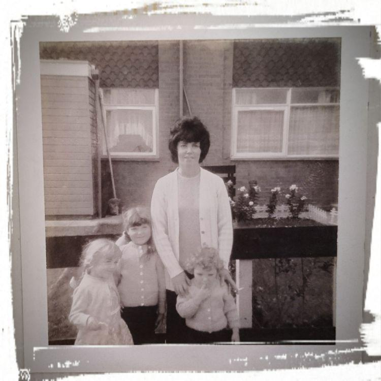 Black and white photo from early 70s, Sharon in the arms of her mother
