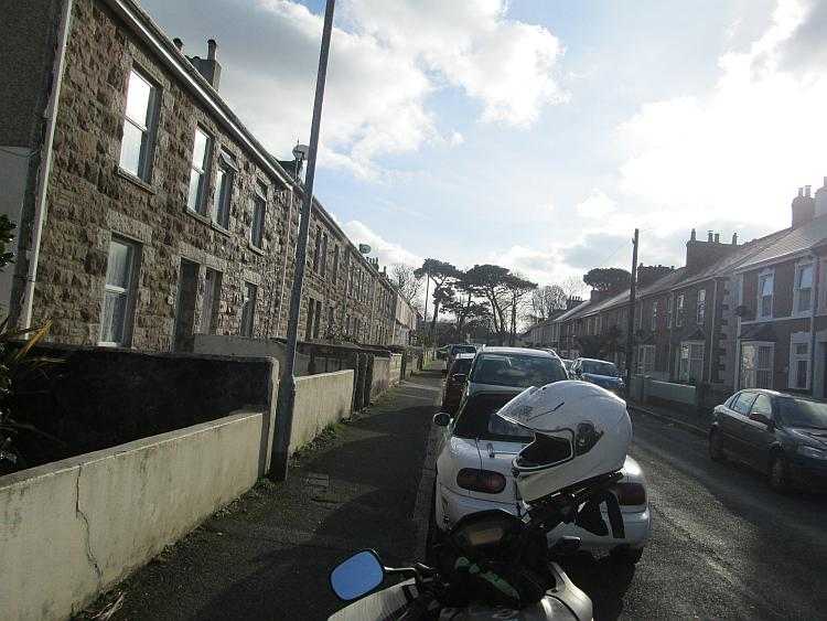 A regular street in camborne complete with houses and sun