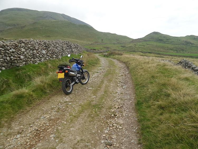 Bob's Vigor 650 along a stony train amidst the Welsh mountains