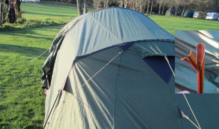 The tent has a peculiar angle due to the broken pole, there's an inset of the snapped aluminium tube