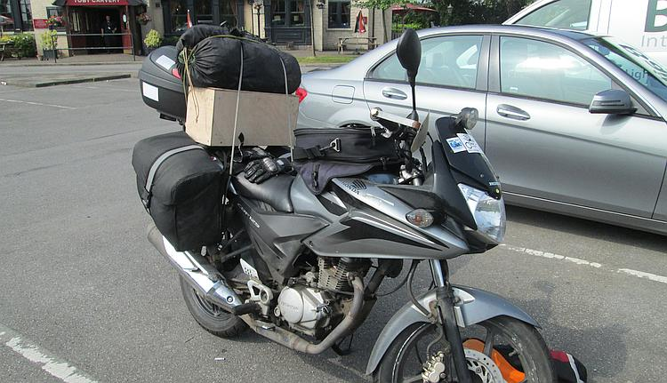 The old CBF125 and a full load of camping luggage