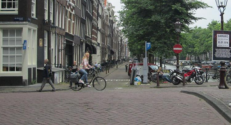 A female Dutch cyclist riding through Amsterdam
