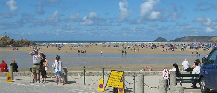 Perrnaporth's broad sandy beach filled with holiday makers in summer