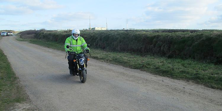 Ren in his high visibility jacket sat on the small but perfectly formed Grom 125