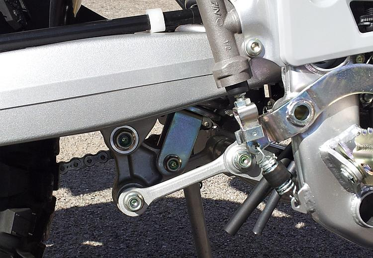 A progressive suspension linkage on a motocross bike