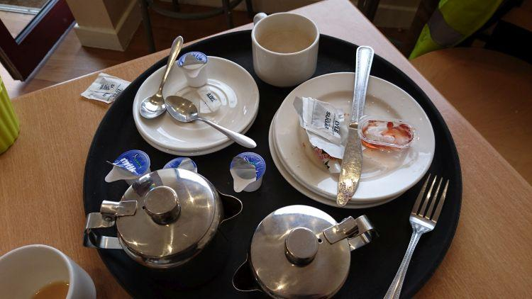 Our empty plates and tea pots on the table of the cafe