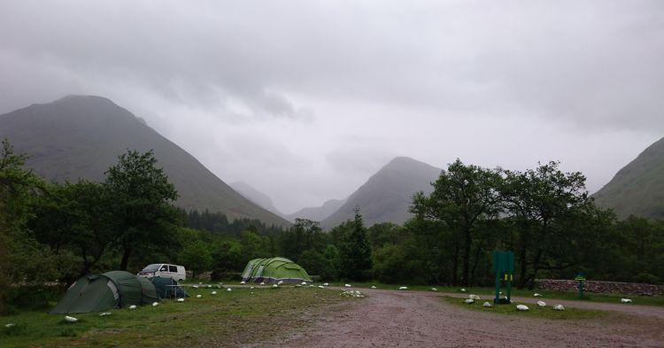 Massive hillsides in the mist and dark clouds at Glencoe and The Red Squirrel campsite