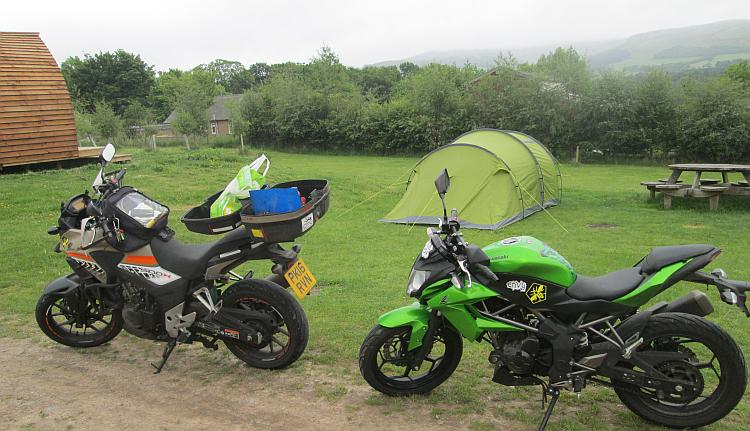 The Honda and Kawasaki next to the tent at Glentress Forest Lodges