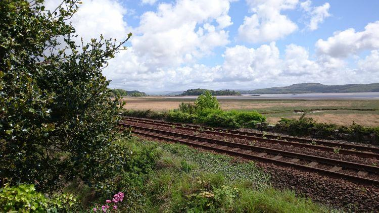 Railway lines and vast broad flat bay, looking from Grange Over Sands to Morecambe