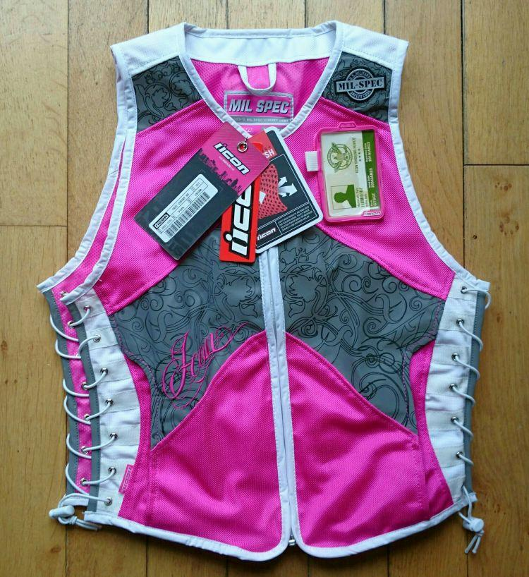 Icon's Mil-Spec vest in deep pink with lots of decorative designs on the reflective panels