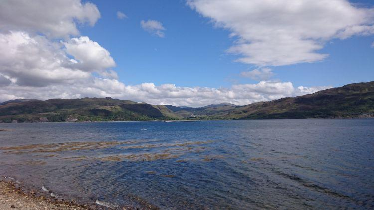 Impressive Loch Carron with blue skies and a little seaweed in the waters