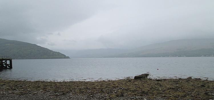 Looking out over Loch Fyne we see massive hills and mountains through the rain and mist