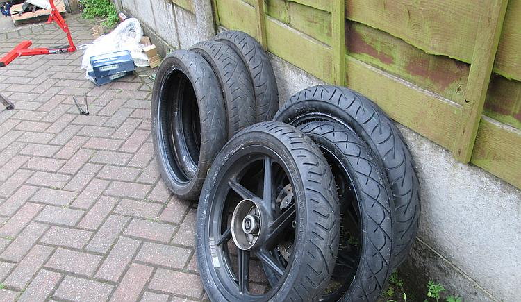 A pile of new and used motorcycle tyres