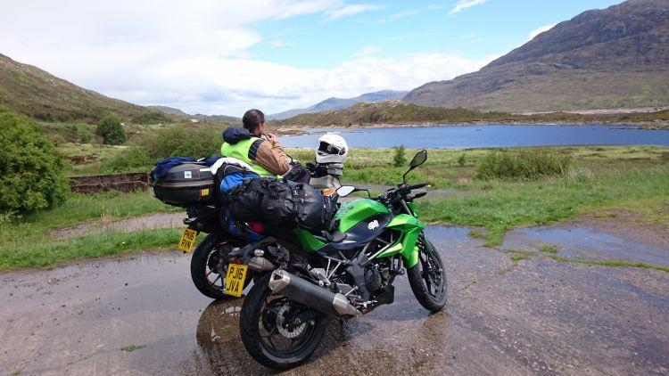 Ren sits on his bike overlooking the magnificence of Loch Duich